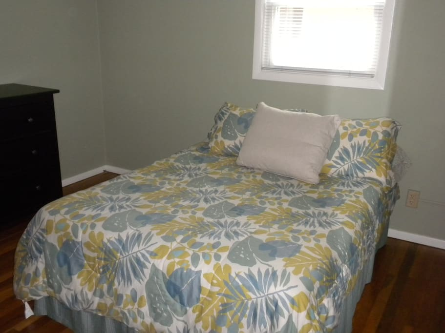 one of the guest rooms, with queen bed and dresser