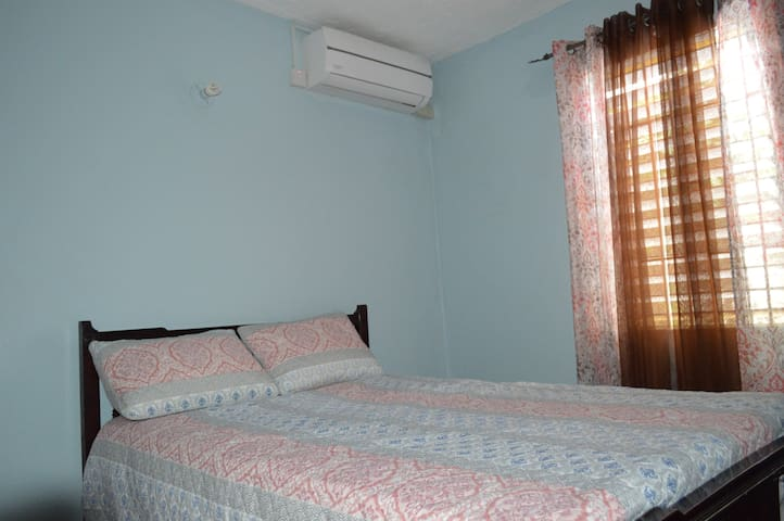 Picture of beautiful Bedroom # 3 showing an array of matching wall color and accessories, bedsheet, pillow and curtains with A/C