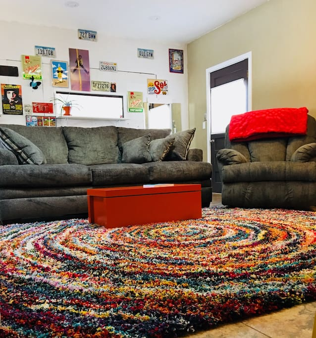 Plush rug to keep you warm, sofa with a pull out queen bed with a memory foam mattress, and a rocking recliner!