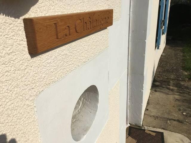 Carved Name Sign & Bulls Eye Window