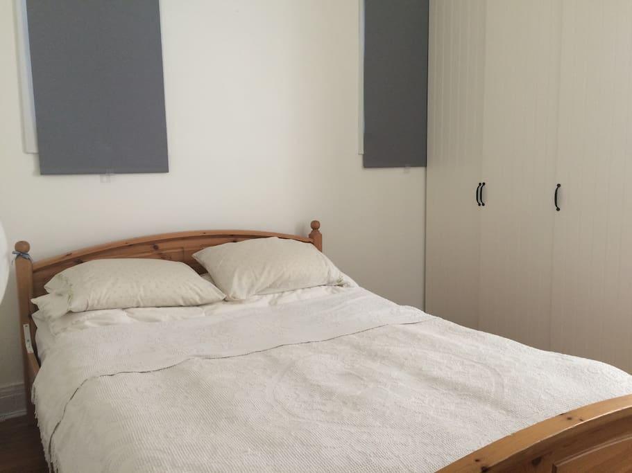 Tidy and quiet bedroom with super comfortable pillow-top queen mattress