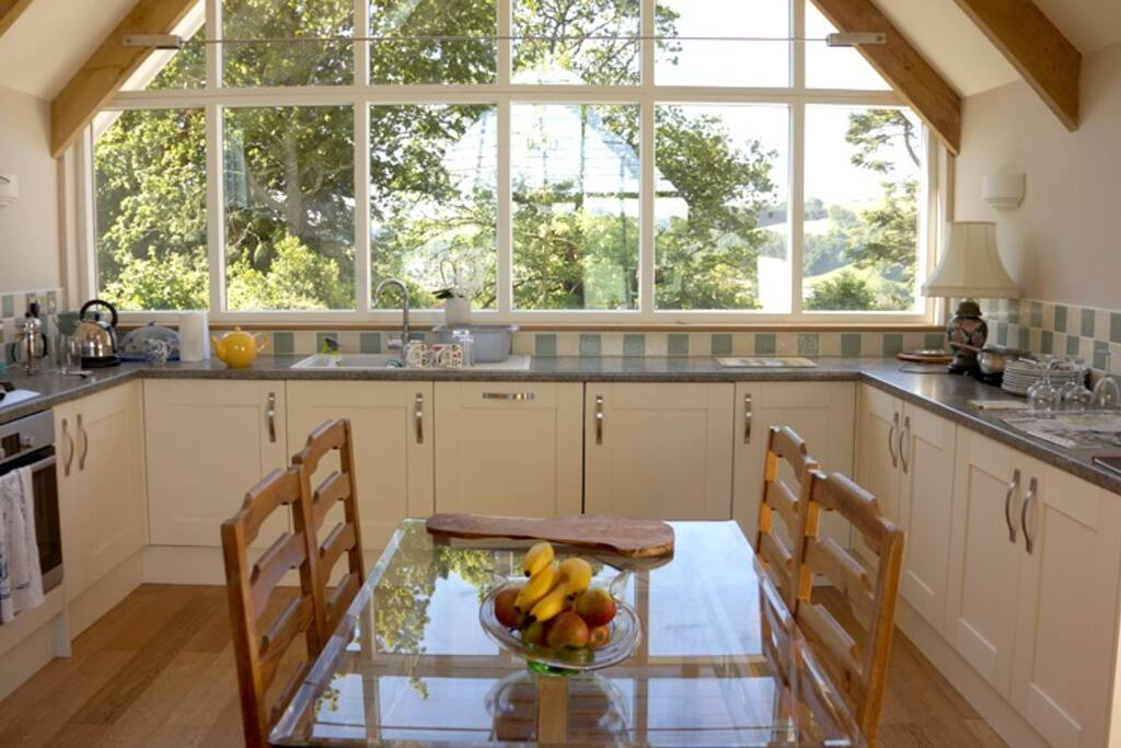 The kitchen area with retro chic table and chairs and a great view across the Dart valley.