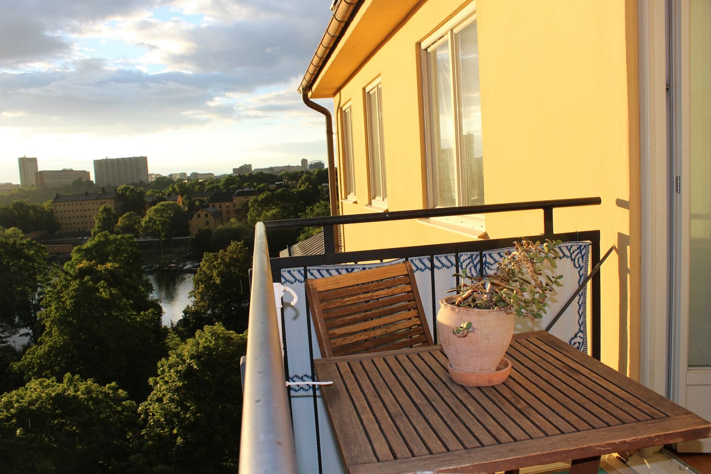 Sunny balcony from noon until sunset overlooking the water.