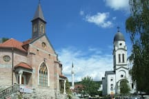 A Catholic church (left), a Serbian Orthodox church (right), and a mosque (center background) in Bosanska Krupa