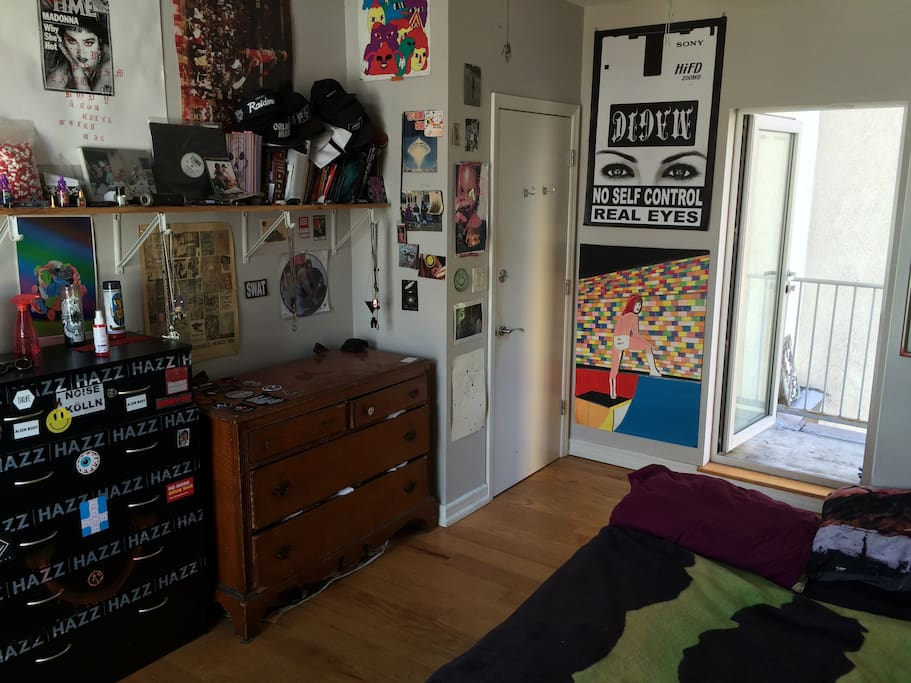 the room has a lot of my personal belongings and art inside of it.