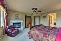 The master bedroom features a gas fireplace, king bed, and en-suite bath.