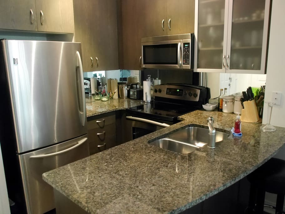 Stainless steel kitchen with granite countertops