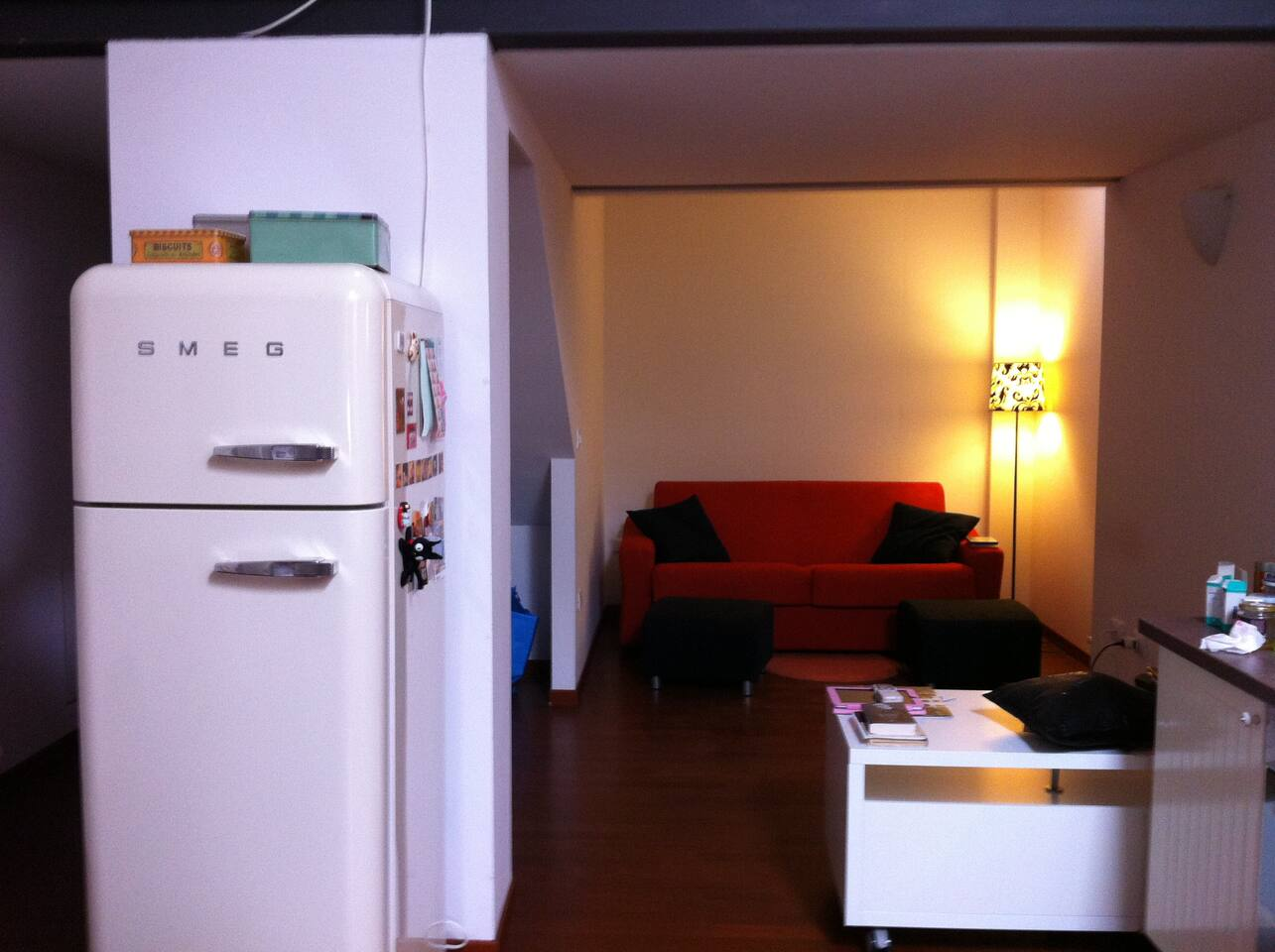 This is the view of the living room from the kitchen. It is a very luminous and bright space.