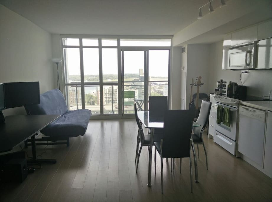 There is an open-concept design in the condo. Floor to ceiling windows highlight the lake view.