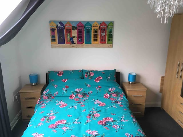 Double room with private bathroom on top floor .
