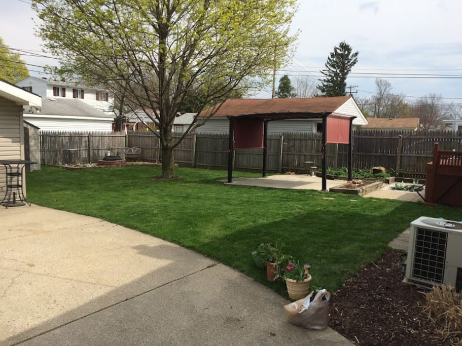 Shot of the Back Yard, with bonfire pit, canopy