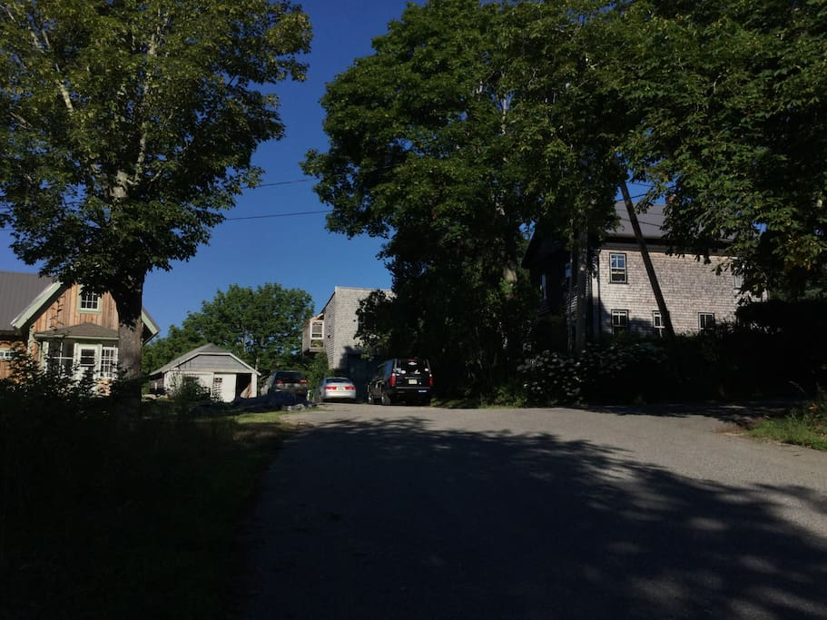 The little house on the left, our big house on the right, driveway in between