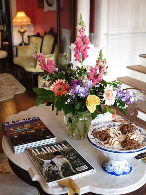 Fragrant flowers and scrumptious treats await Guests at entry parlor