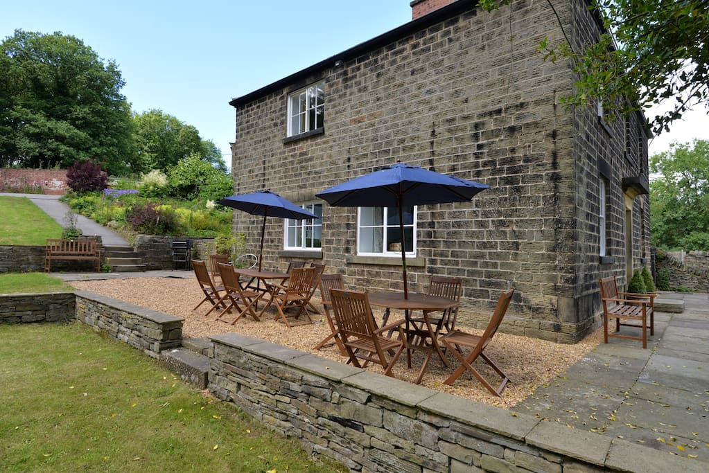Seating, parasols and a barbeque at the ready