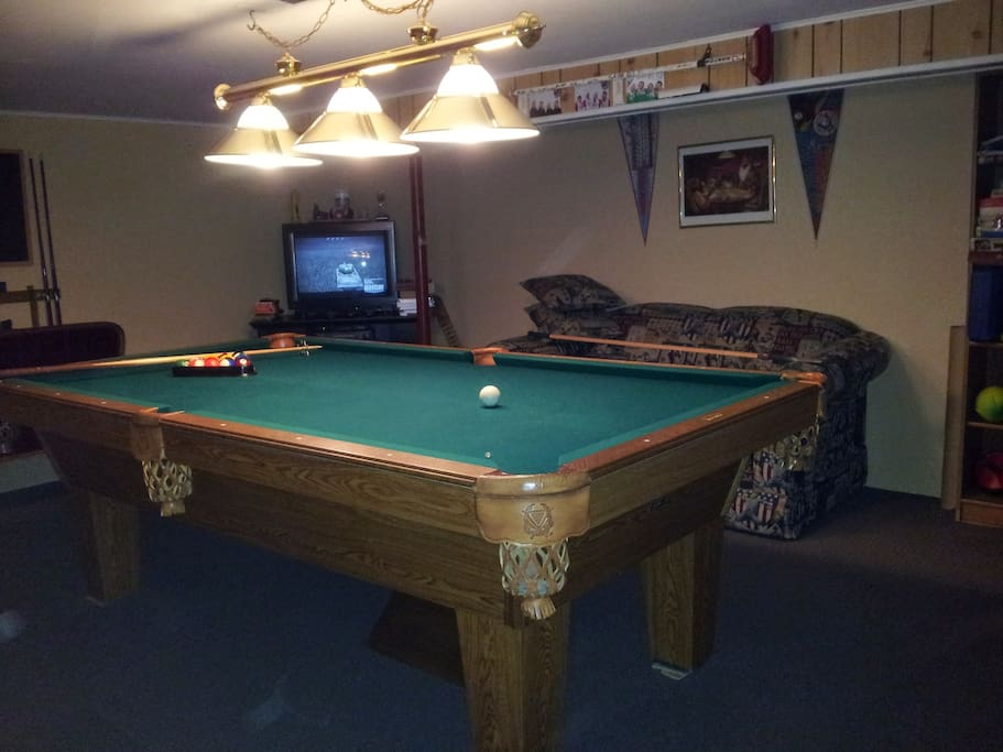Games room with upgraded satellite TV, VCR, sports videos, electric fireplace, darts, board games