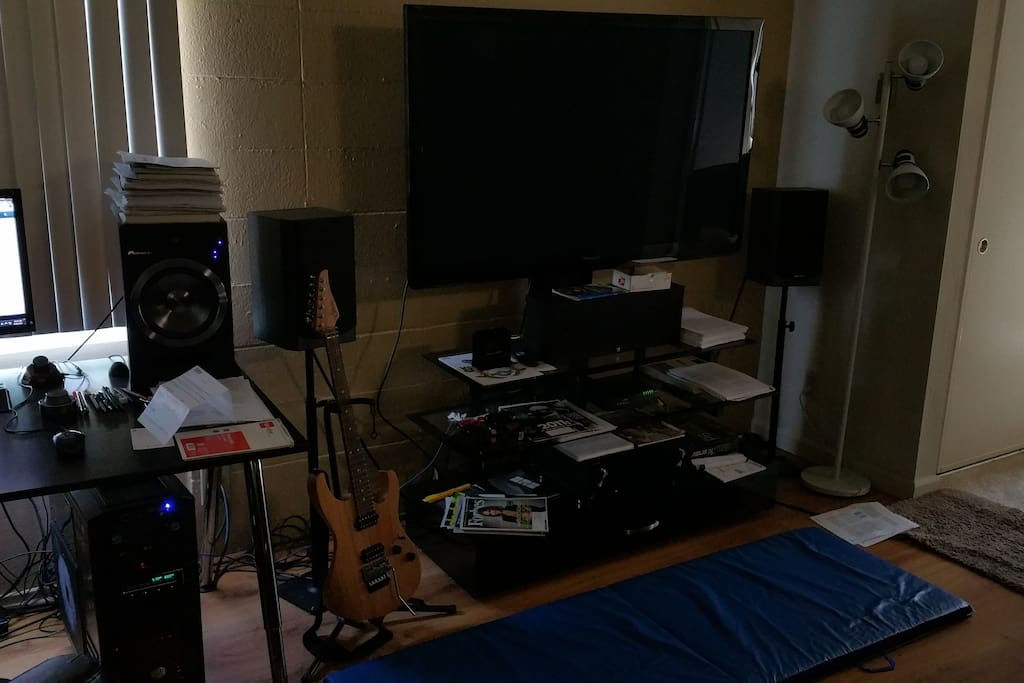 """55"""" HDTV with an excellent 5+1 sound system. Exercise mat, dumbells, guitar etc."""