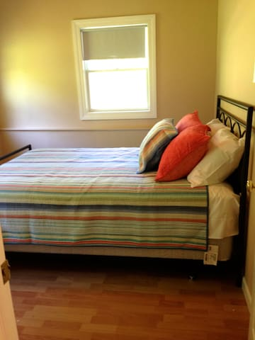 Bedroom #1: Queen sized bed with closet space and linens