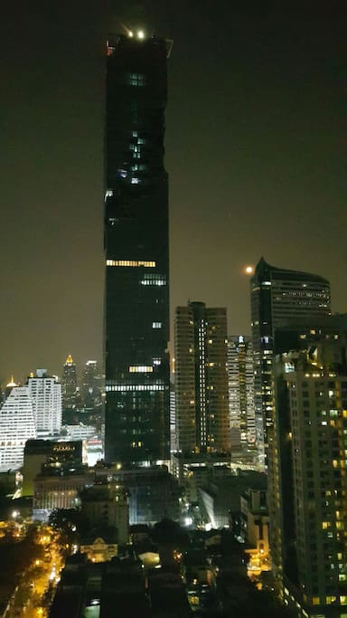 View from the living room overlooking the tallest elegant building of Thailand.