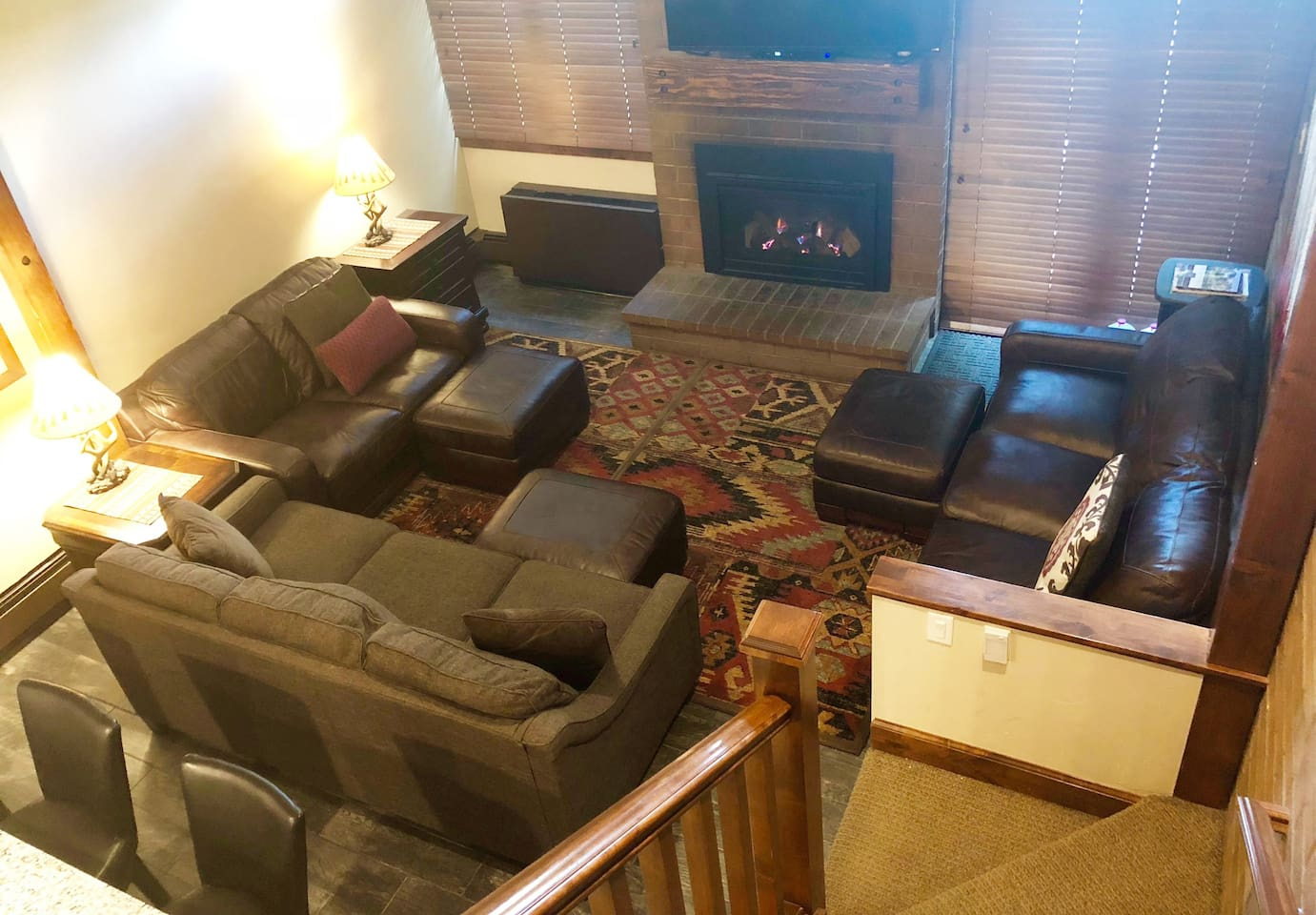 The living room provides an excellent place to relax, watch tv, and sit by the cozy fire. Plenty of seating for everyone to stretch out!