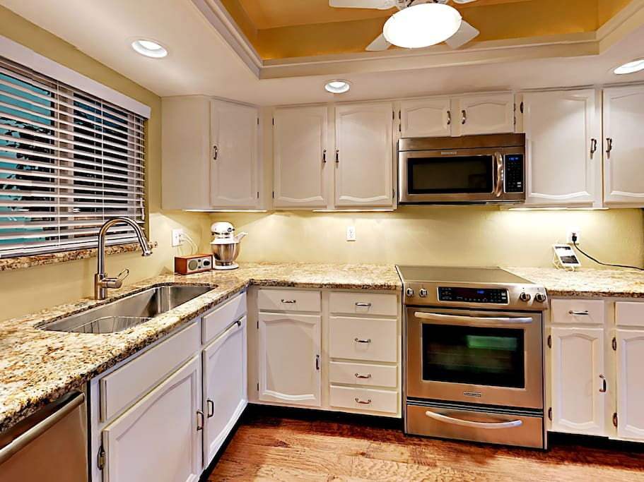 The kitchen with granite countertops and a full suite of stainless steel appliances