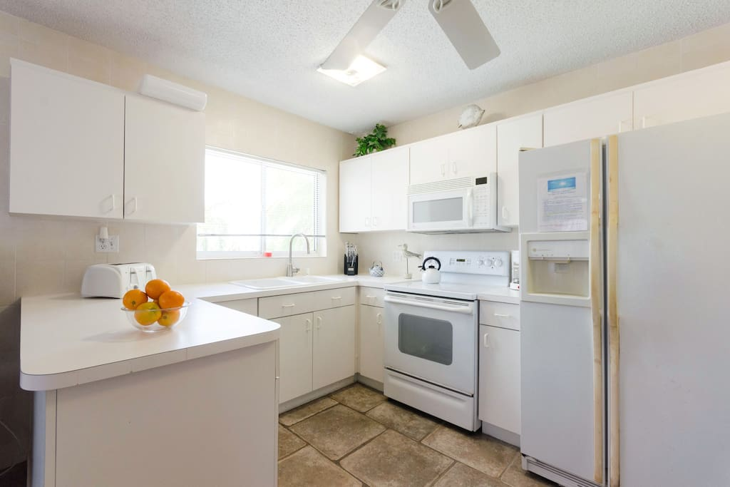 Fully stocked kitchen with plenty of cookware & dishes to prepare a meal!