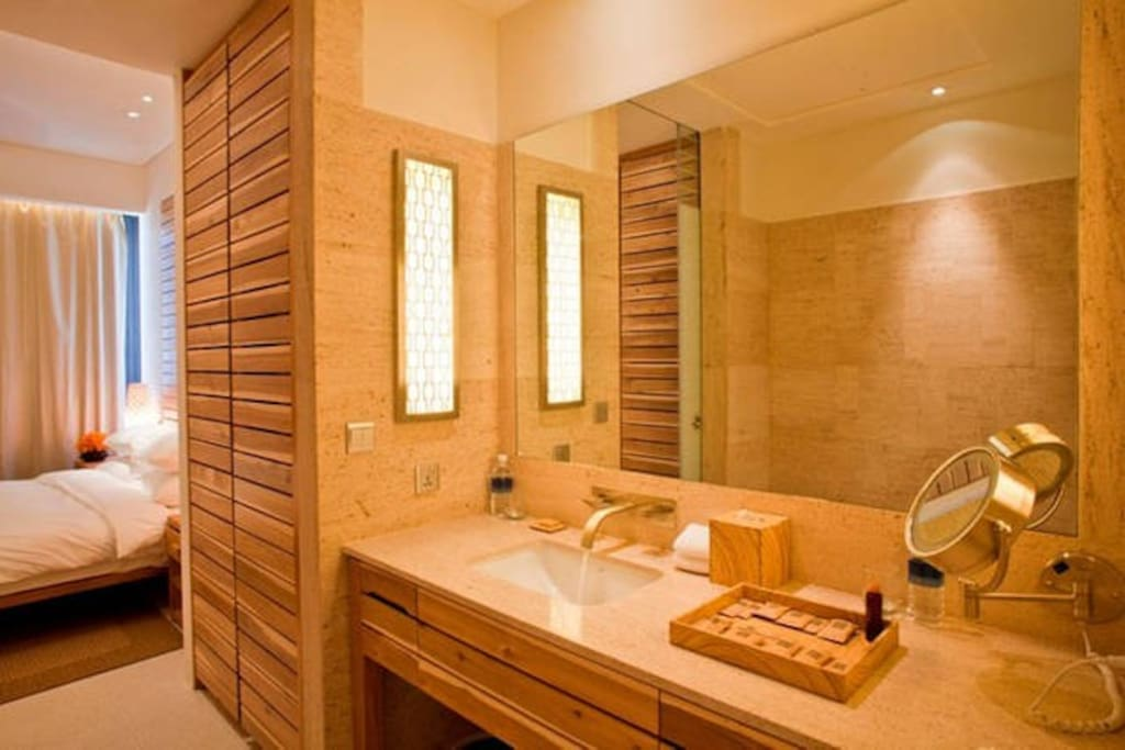 Marble washroom with both bathing and showering facilities. Shampoo and shower gel is refilled daily.