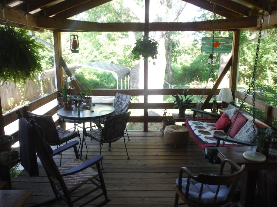 Screened-in back porch, BBQ, table for four and swing seat