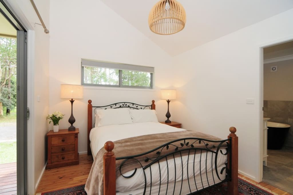 The main bedroom has a queen sized bed and opens onto the little verandah