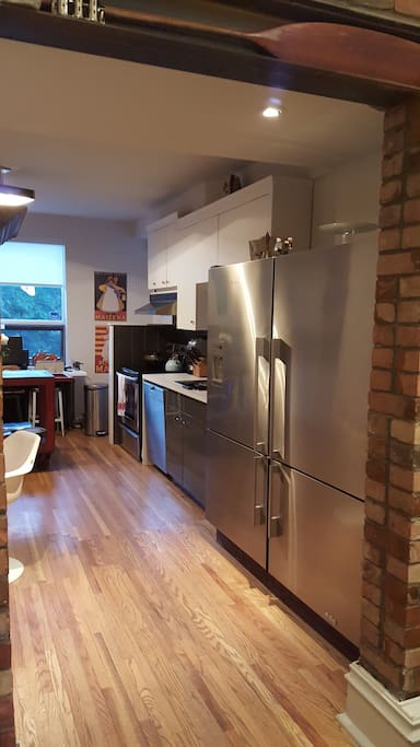 Large kitchen with double stainless steel fridge and freezers