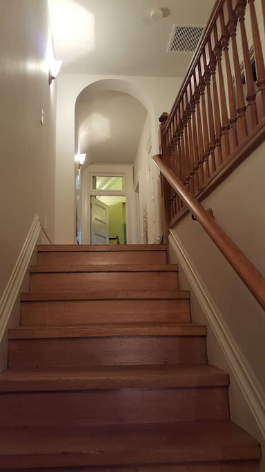 Extra high ceilings and soaring staircases - original hardwood throughout