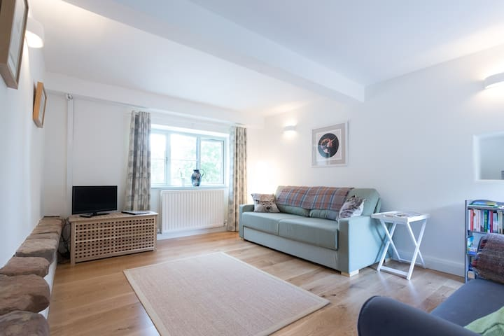 """Sitting room with views across the garden (not shown in photo - new 40"""" Smart TV)"""