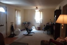 2nd half of living room area, large table/desk, maps & brochures. Ceiling fan, window fan and AC unit. Winter months; electric space heater & electric radiator heater. Wireless secured internet device on desk table.