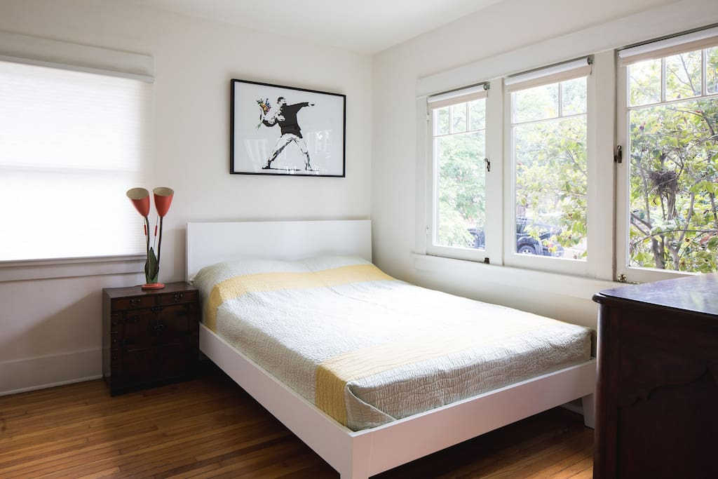 Light filled master bedroom with queen sized bed. (AC unit has been added in window.)