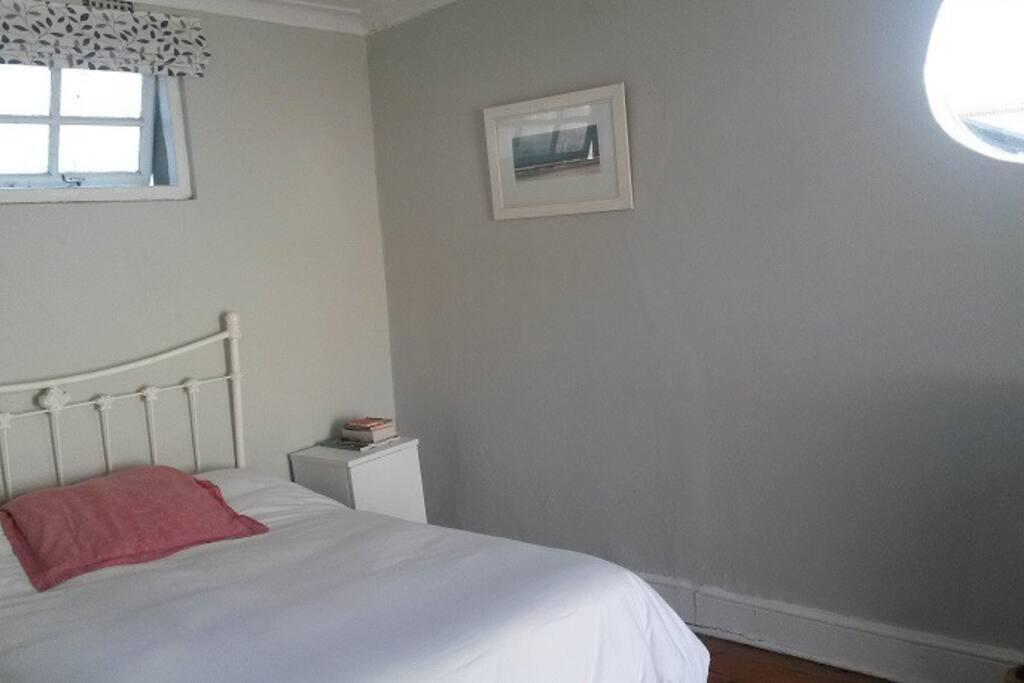 Bedroom, double bed, round window.