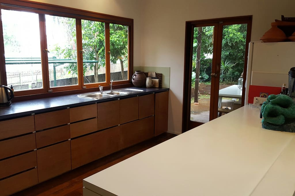 Well equipped  kitchen leading onto back deck