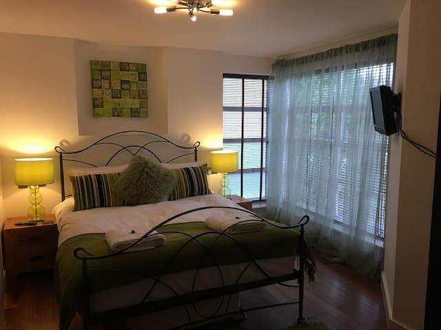 2nd bedroom with king size bed, TV DVD, ensuite shower room.