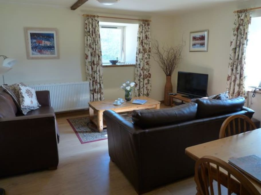 "The lounge/diner with leather sofas, 37"" flat screen tv and surround sound. Lots of books and magazines to entertain you."