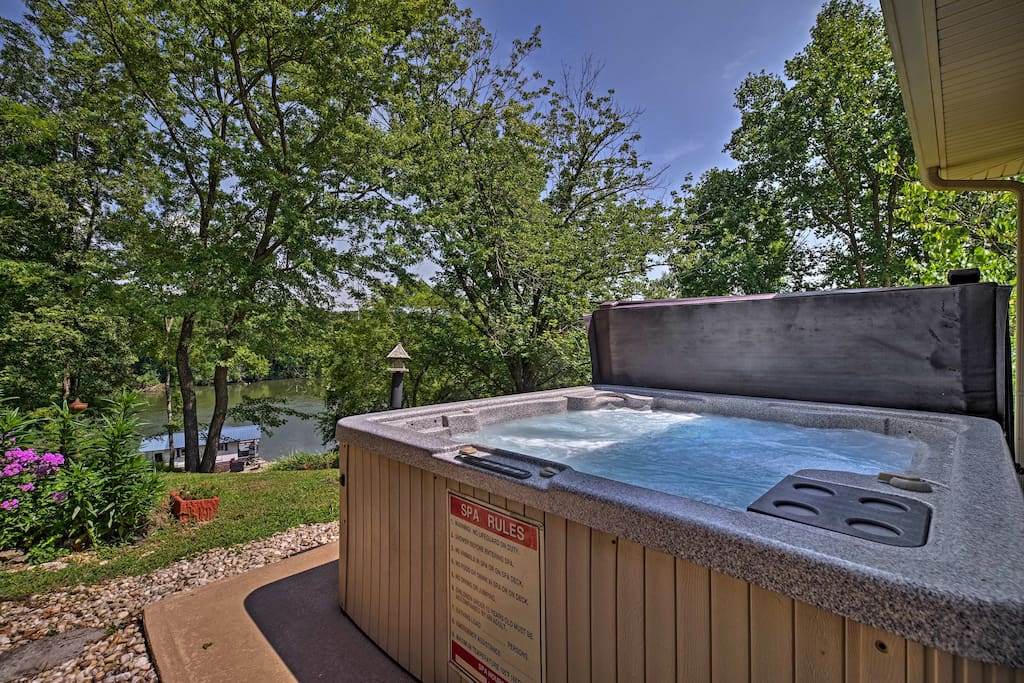 This waterfront property features a private outdoor hot tub and patio!