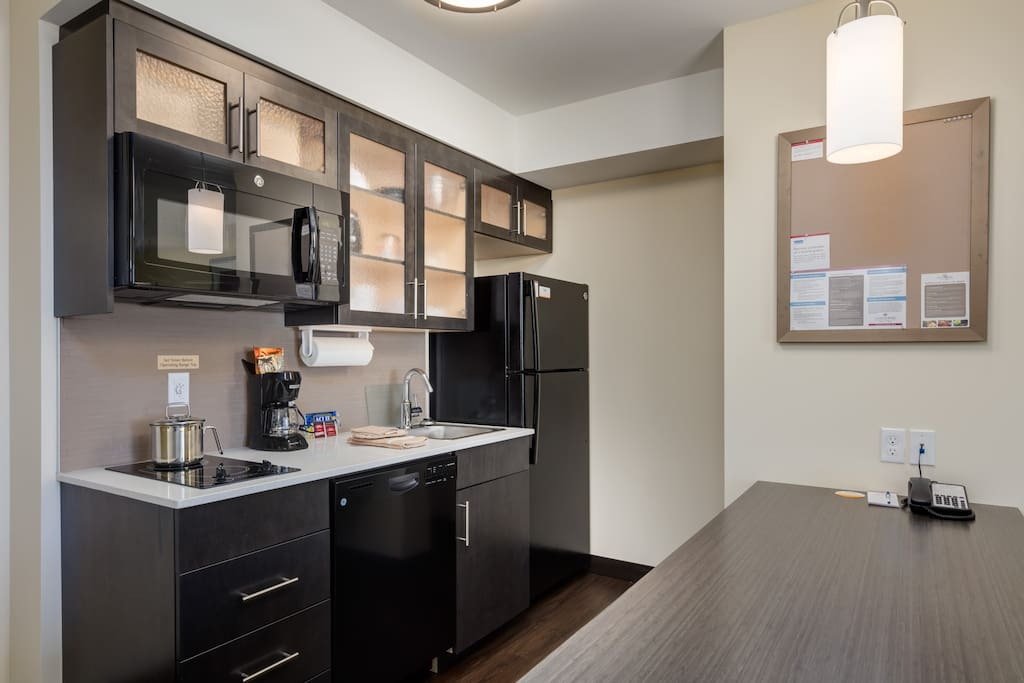 Full Kitchen (including full size fridge, microwave, dishwasher and stove top)