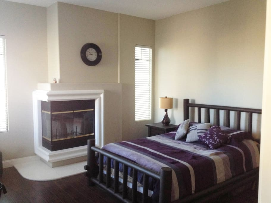 Large Bedroom Suite with attached master Bathroom including double sink, large tub, separate enclosed shower, and a restroom with it's own door for privacy.