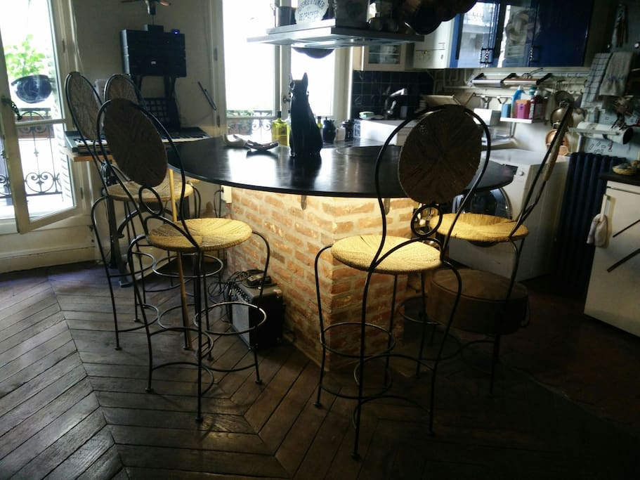 Snail shaped table  with 5 bar chairs