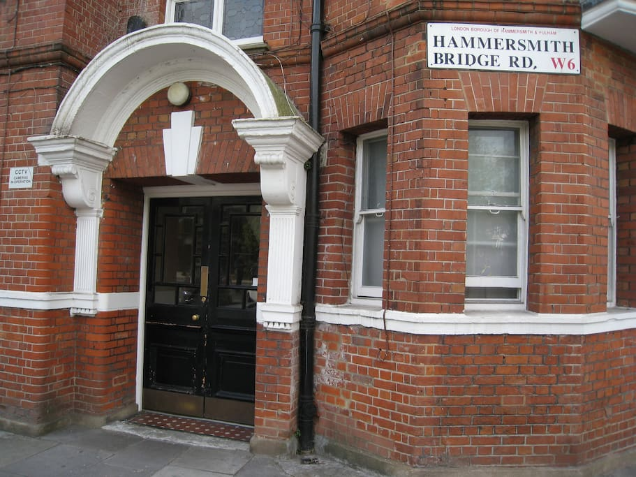 Entrance 10-19, Corner Hammersmith Bridge Road & Rutland Grove (near the post box)