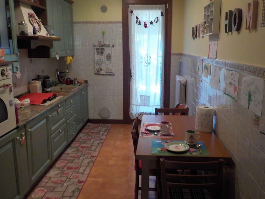 Italian kitchen includes dishwasher, Nespresso coffee machine, big fridge, 3 regular + 1 child chairs (door to the garden)