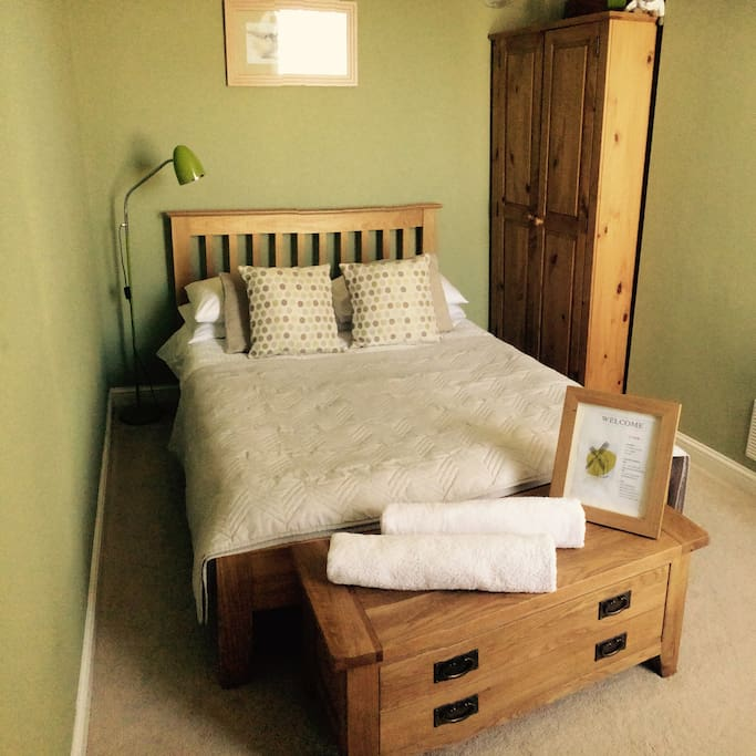 Double bedroom with solid oak furniture- double bed, blanket box, wardrobe and dressing table