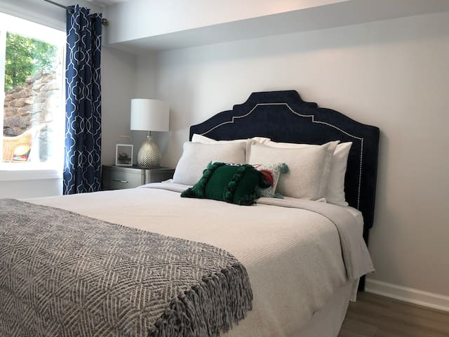Bright and comfortable bedroom (1st of 2 bedrooms) with queen bed and closet.