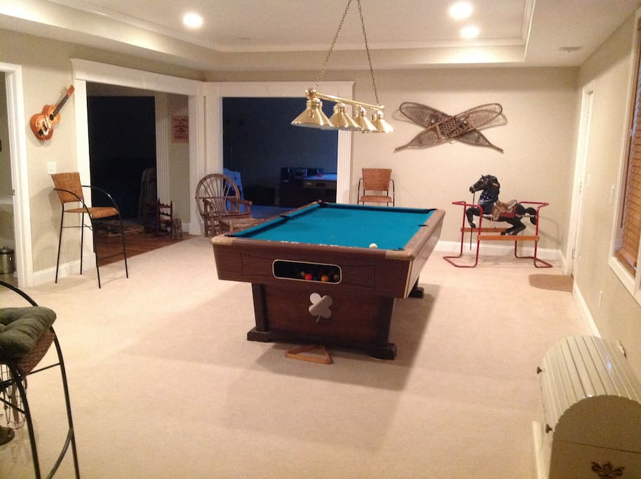 Play a round of pool or a game of air hockey in Full Finished Basement