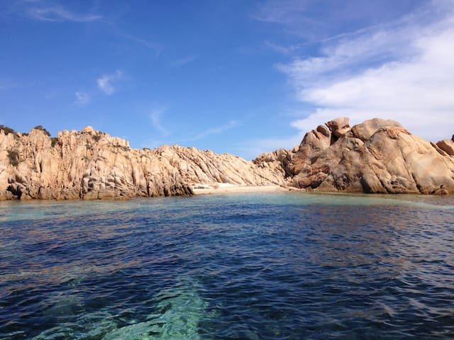 Rent a rubber boat ( Paolo in Baja Sardinia has good prices) and go to the islands ! Caprera in front of you...