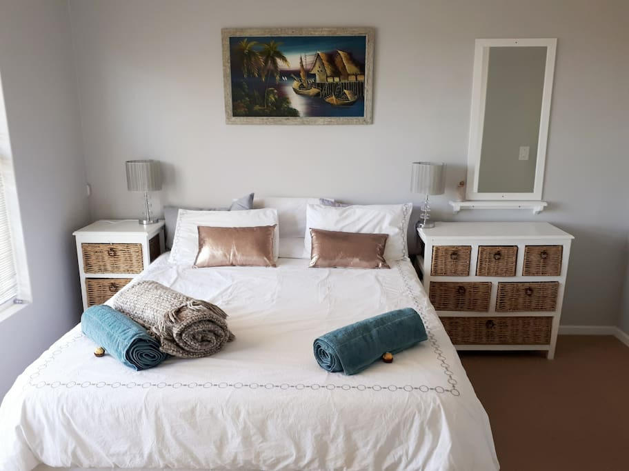 Main bedroom #1. Queen bed with a super comfy Cloud9 mattress with a private en-suite bathroom, built-in-cupboards and bed side draws for clothing and other storage spaces. Your bedroom is equipped with sufficient charging ports as well as mosquito mats for the Summer nights.