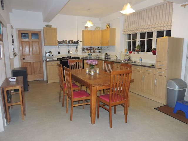 Kitchen and Dining table with Aga.