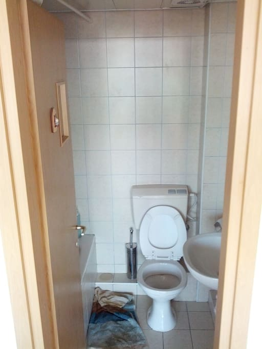 Bathroom, nice, clean & new. Tub inside.